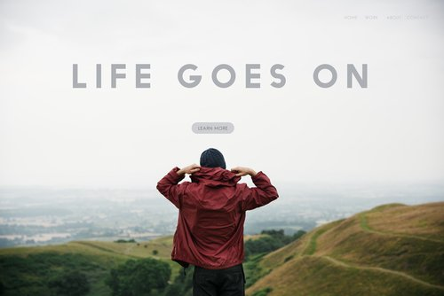 Life goes on graphic man on a hillside